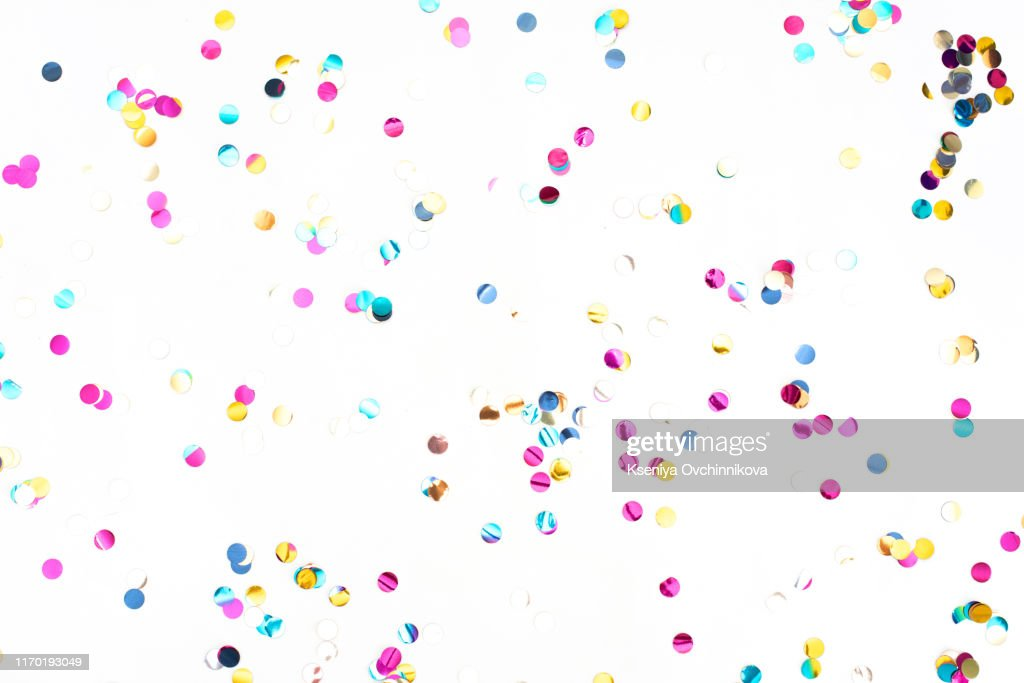 colourful sparlking confetti on white background : Stock Photo