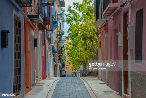 colourful street in villajoyosa,  valencia, alicante, spain - alicante stock pictures, royalty-free photos & images