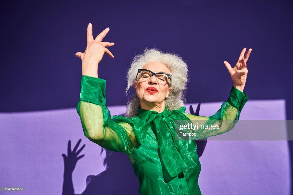 Colourful studio portrait of a senior woman : Photo