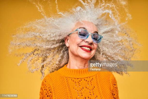 colourful studio portrait of a senior woman - one senior woman only stock pictures, royalty-free photos & images