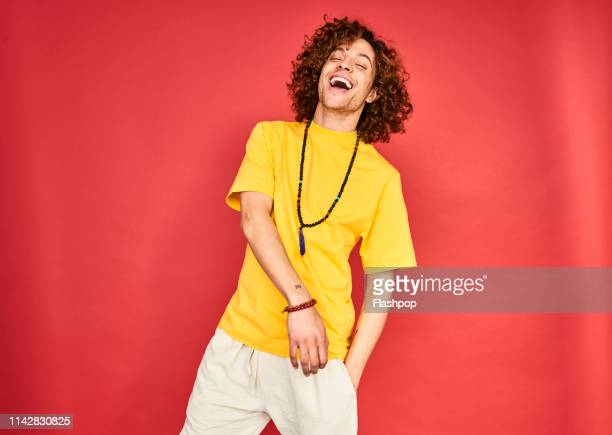 colourful studio portrait of a young man - ダンス ストックフォトと画像