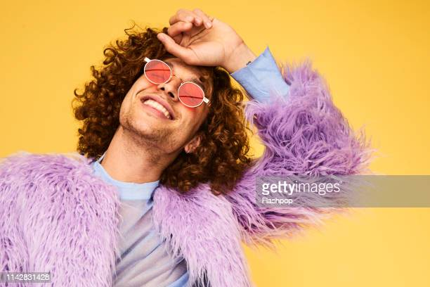 colourful studio portrait of a young man - social justice concept stock pictures, royalty-free photos & images
