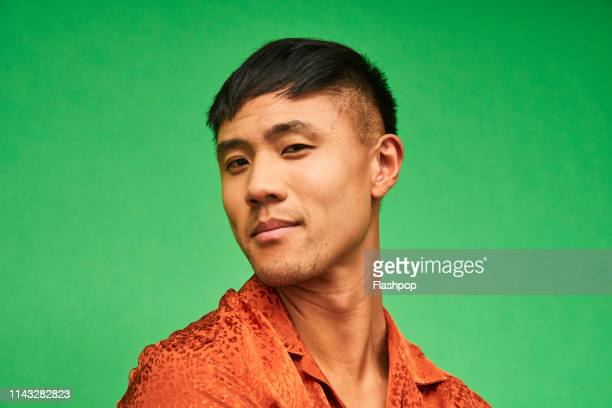 colourful studio portrait of a young man - east asian ethnicity stock pictures, royalty-free photos & images