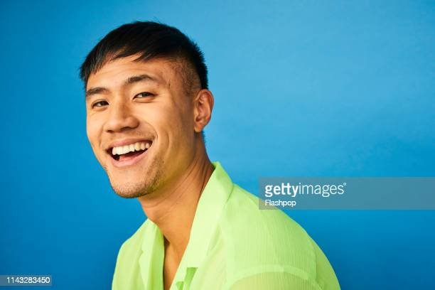 colourful studio portrait of a young man - multi coloured stock pictures, royalty-free photos & images
