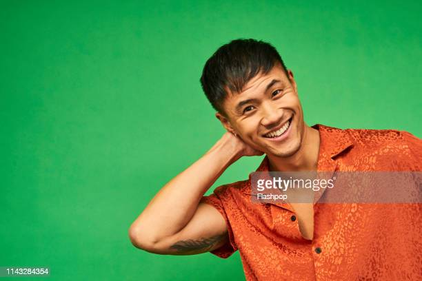 colourful studio portrait of a young man - one man only stock pictures, royalty-free photos & images