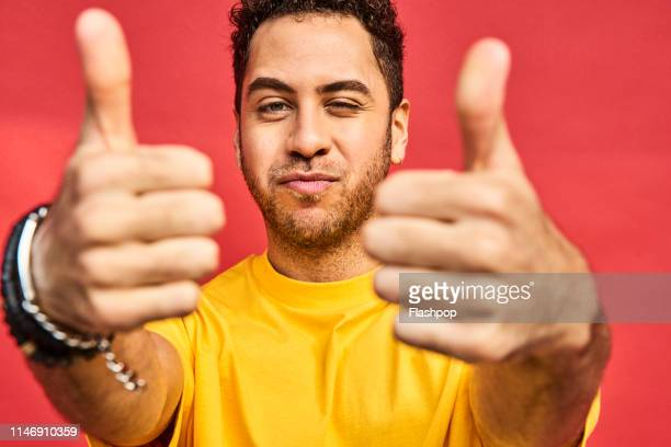colourful studio portrait of a young man - carefree stock pictures, royalty-free photos & images