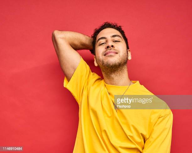 colourful studio portrait of a young man - gay man stock pictures, royalty-free photos & images