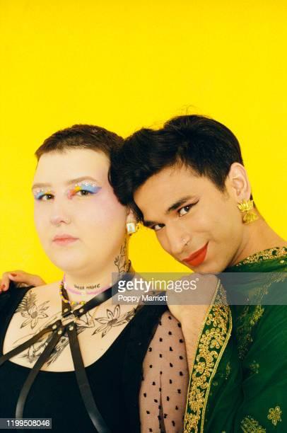 colourful studio portrait of a young non-binary friends - gender fluid fotografías e imágenes de stock