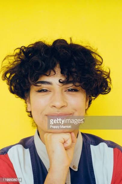 colourful studio portrait of a young non-binary individual - gender fluid stock pictures, royalty-free photos & images