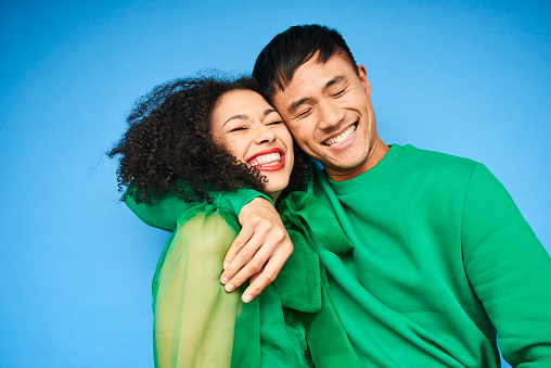 Colourful studio portrait of a young woman and man - gettyimageskorea