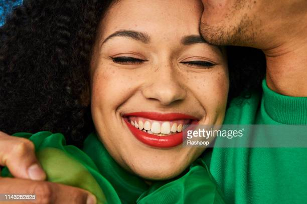 colourful studio portrait of a young woman and man - satisfaction stock pictures, royalty-free photos & images
