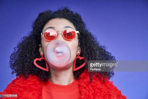 colourful studio portrait of a young woman - bubble gum stock pictures, royalty-free photos & images