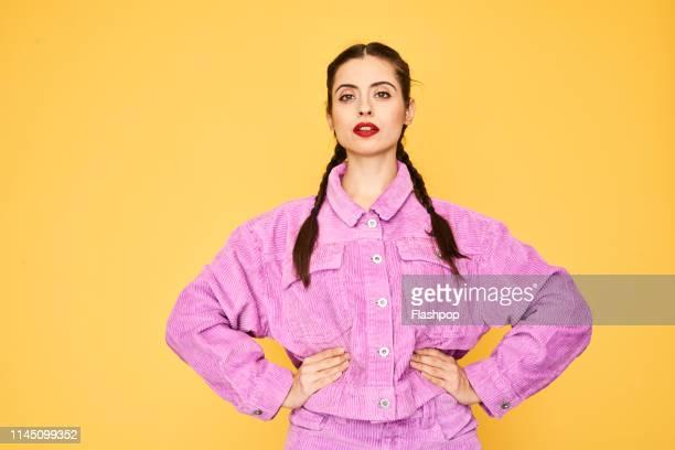 colourful studio portrait of a young woman - confiance en soi photos et images de collection