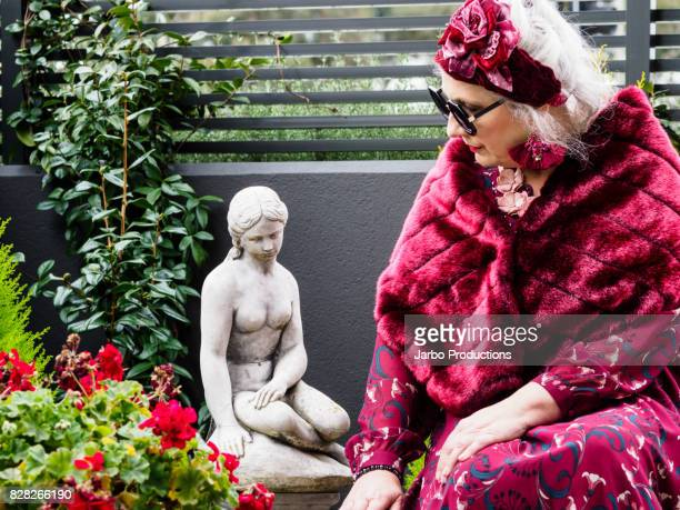 colourful stylish senior poses in garden - shawl stock pictures, royalty-free photos & images