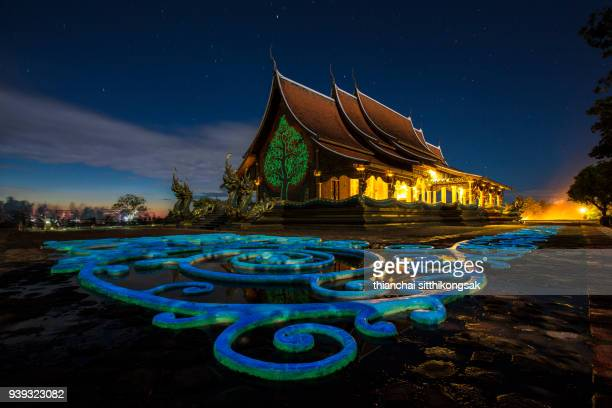 colourful temple during day to night time - buddhist new year stock pictures, royalty-free photos & images