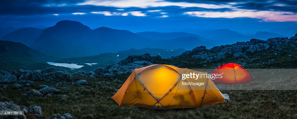 Keywords & Female Hiker Relaxing Outside Tent On Mountain At Sunset Panorama ...