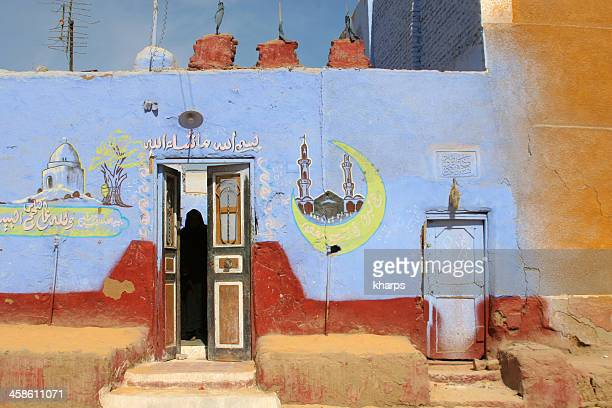 Colourful, traditional Nubian home, Egypt with Haj drawings
