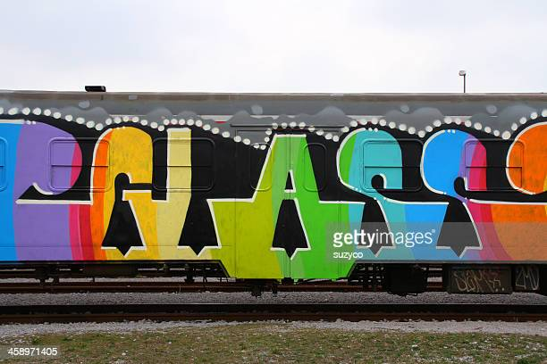 colourful train - train graffiti stock photos and pictures
