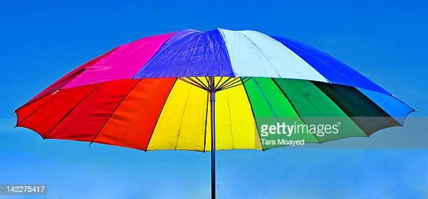 Colourful umbrella against sky