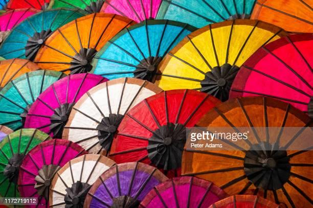 colourful umbrellas at street market in luang prabang, laos - peter adams stock pictures, royalty-free photos & images