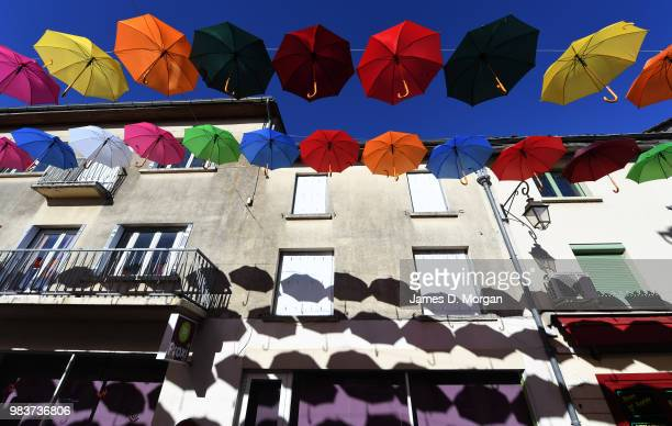Colourful umbrellas hang above the main street as part of a summer art installation to brighten the town for locals and visitors on June 25 2018 in...