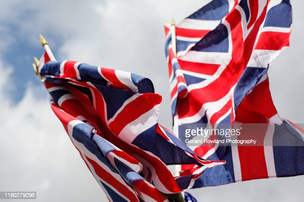 colourful union jacks - political party stock pictures, royalty-free photos & images