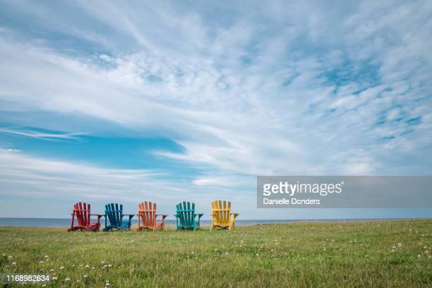 colourful vacation chairs looking out over the sea - atlantic ocean stock pictures, royalty-free photos & images