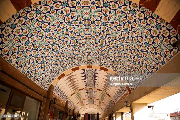 colourful vaulted mosaics ceiling of building in urgup, turkey - ネヴシェヒル県 ストックフォトと画像