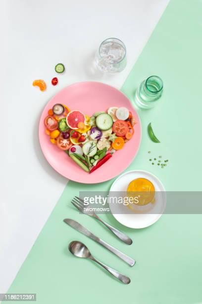 colourful vegan food eating conceptual still life. - gezonde voeding stockfoto's en -beelden
