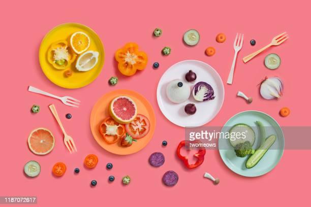 colourful vegan food eating conceptual still life. - vegan - fotografias e filmes do acervo