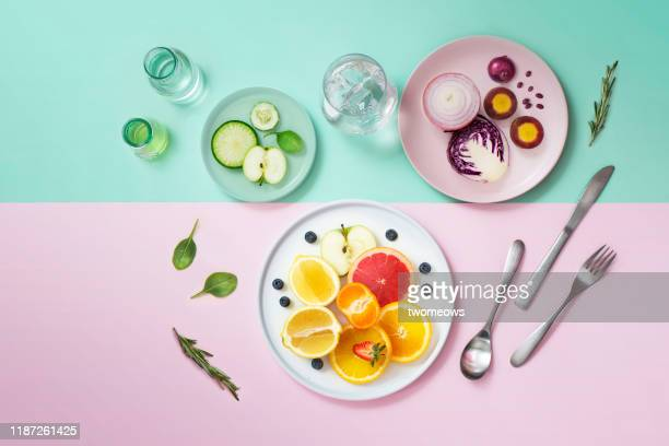 colourful vegan food eating conceptual still life. - detox stock pictures, royalty-free photos & images