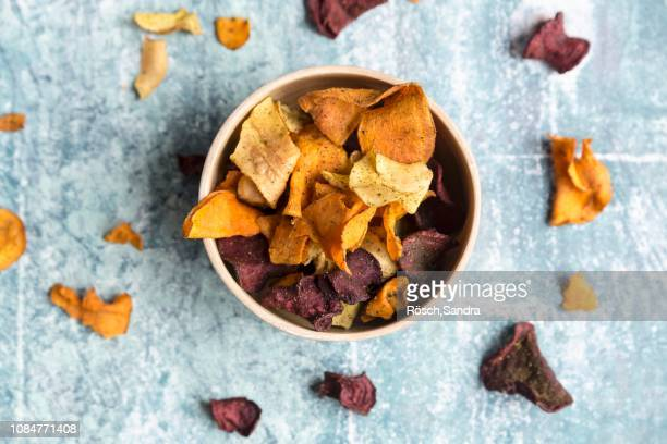 colourful vegetable crisps in a bowl - computer chip stock pictures, royalty-free photos & images