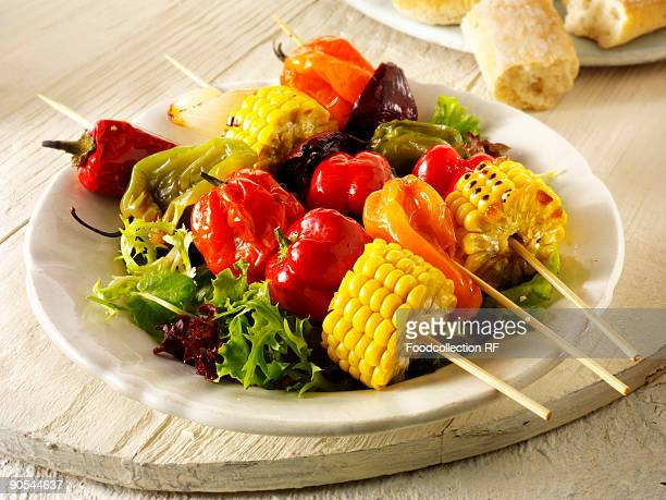 colourful vegetable kebabs on salad leaves, close up - vegetable kebab stock pictures, royalty-free photos & images