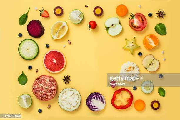 colourful vegetables and fruits text space still life. - zitrusfrucht stock-fotos und bilder