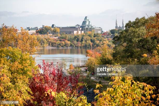 Colourful views of the Ottawa river in autumn with changing leaves