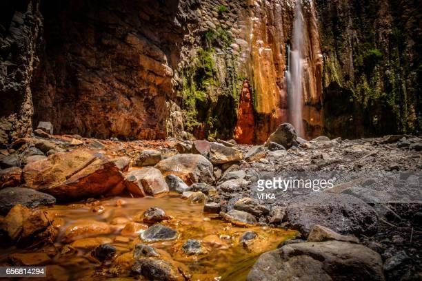 """colourful waterfall """"cascada de los colores"""" at caldera de taburiente, la palma, spain. - caldera stock pictures, royalty-free photos & images"""