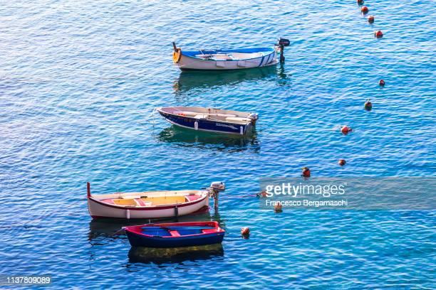 colourful wood boats. riomaggiore, cinque terre, liguria, italy, europe. - italia stockfoto's en -beelden