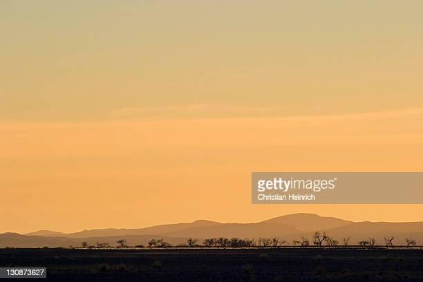 Colourfull sunset in the dry Tsauchab river, Namib Desert, Namibia