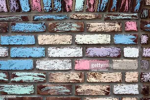 Colourfully chalked brick wall