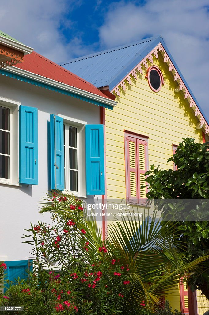 Colourfully painted buildings at Orient Beach, St. Martin (St. Maarten), Leeward Islands, West Indies, Caribbean, Central America : Stock Photo