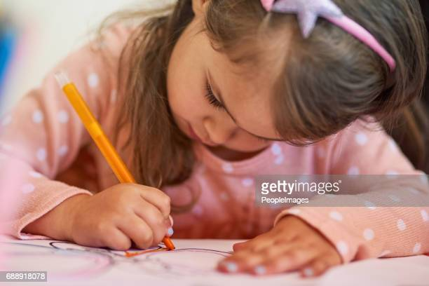 colouring in is her favourite hobby - colouring book stock photos and pictures