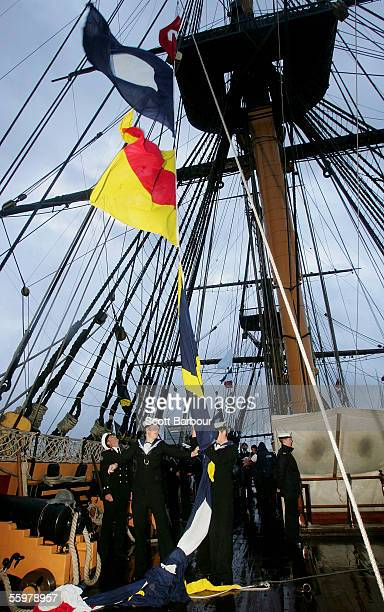 Colours and Admiral Lord Nelson's 'England Expects' signal are hoisted during a memorial service as part of theTrafalgar 200th anniversary...