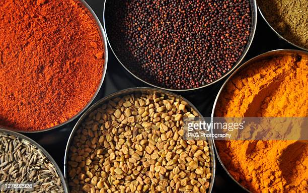 colours in kitchen - spices stock photos and pictures