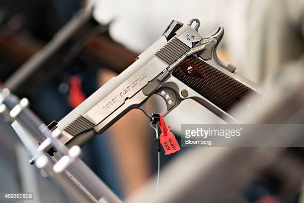 A Colt 9mm pistol sits on display in the Colt's Manufacturing Co booth on the exhibition floor of the 144th National Rifle Association Annual...