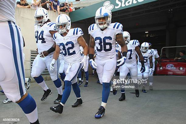 Colt Anderson and Dan Herron of the Indianapolis Colts take the field before the start of the game against the Cincinnati Bengals at Paul Brown...