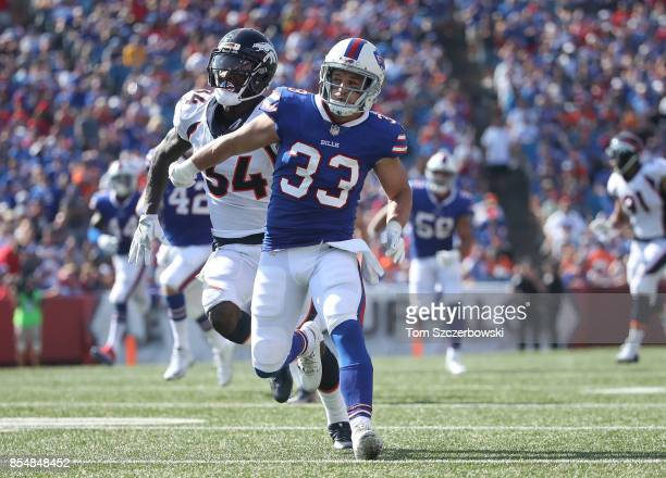 Colt Anderson of the Buffalo Bills hussles down the field as the Bills punt the ball during NFL game action against the Denver Broncos at New Era...