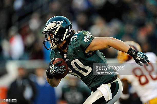 Colt Anderson of the Philadelphia Eagles runs up field after catching an interception thrown by Robert Griffin III of the Washington Redskins during...