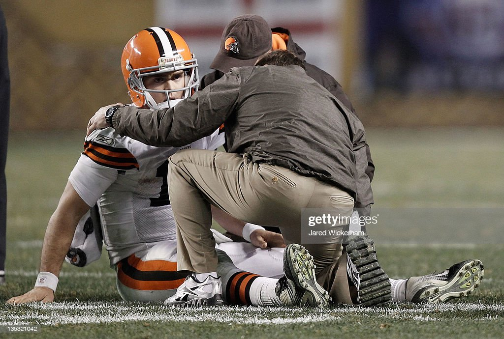 Colt McCoy #12 of the Cleveland Browns lays on the ground while speaking to athletic trainers after a helmet to helmet hit from James Harrison #92 of the Pittsburgh Steelers during the game on December 8, 2011 at Heinz Field in Pittsburgh, Pennsylvania.