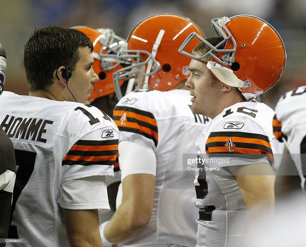 Colt McCoy #12 of the Cleveland Browns talks with Jake Delhomme #17 while playing the Detroit Lions in a preseason game on August 28, 2010 at Ford Field in Detroit, Michigan.