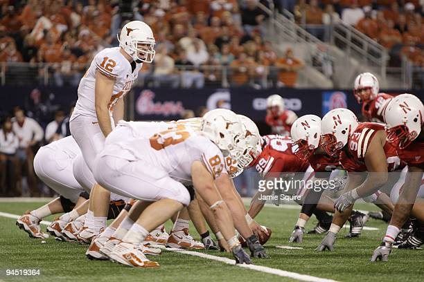 Colt McCoy of the Texas Longhorns calls the play at the line of scrimmage during the Big 12 Football Championship game against the Nebraska...